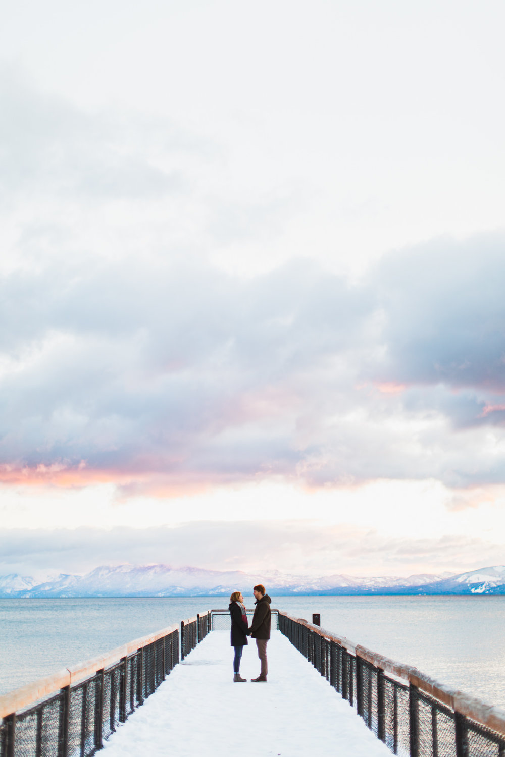 snowy engagement session on lake tahoe | destination engagement photo inspiration | utah adventure elopement photographers | the hearnes adventure photography | www.thehearnes.com