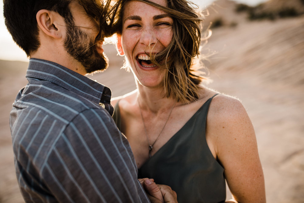 windy utah desert engagement session | destination engagement photo inspiration | utah adventure elopement photographers | the hearnes adventure photography | www.thehearnes.com