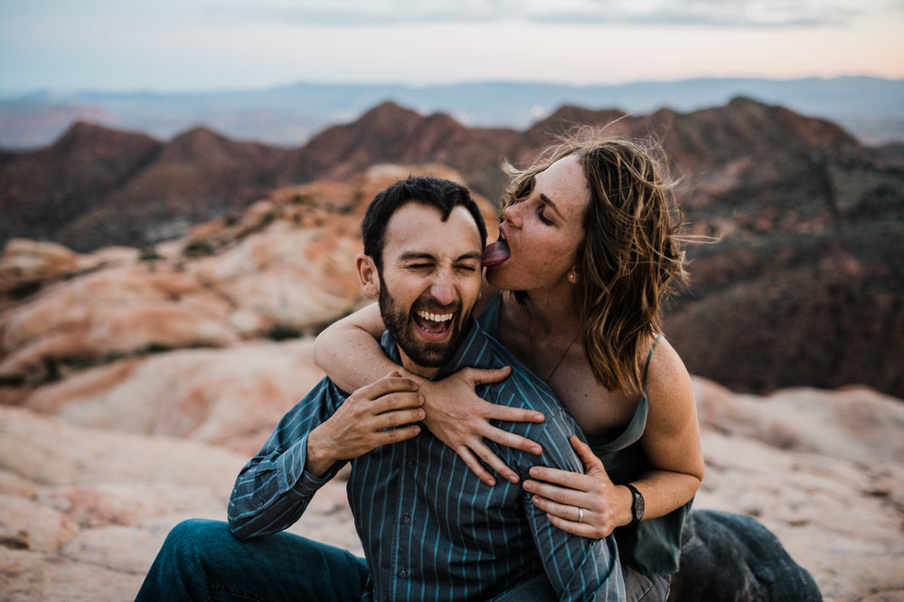 windy adventure engagement session in the utah desert | destination engagement photo inspiration | utah adventure elopement photographers | the hearnes adventure photography | www.thehearnes.com
