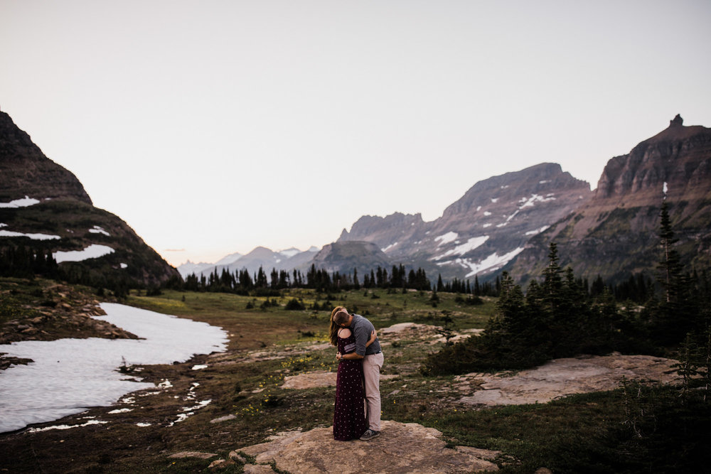 mountain top adventure session in glacier national park | destination engagement photo inspiration | utah adventure elopement photographers | the hearnes adventure photography | www.thehearnes.com