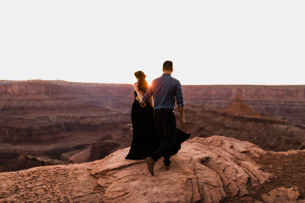 adventure engagement session in moab, utah | destination engagement photo inspiration | utah adventure elopement photographers | the hearnes adventure photography | www.thehearnes.com