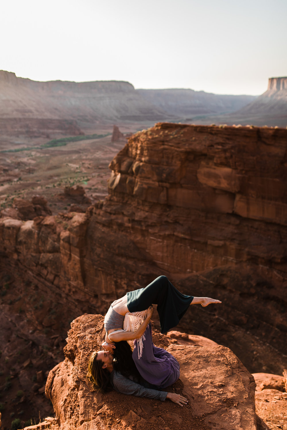 epic acro yoga engagements in moab, utah | destination engagement photo inspiration | utah adventure elopement photographers | the hearnes adventure photography | www.thehearnes.com