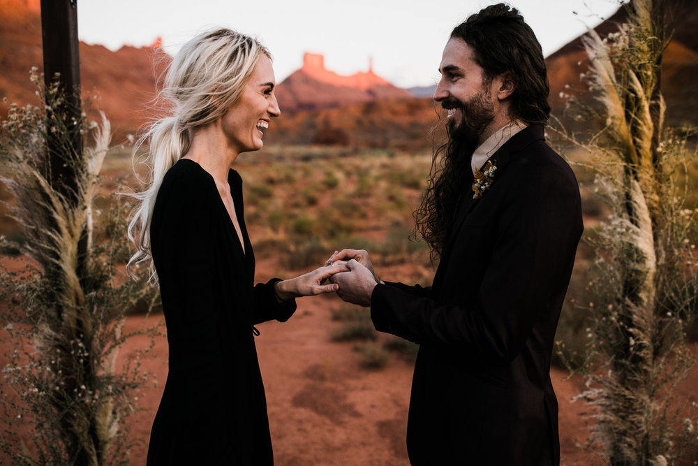 moab, utah elopement + black wedding dress | destination adventure wedding photographers | the hearnes adventure photography | www.thehearnes.com