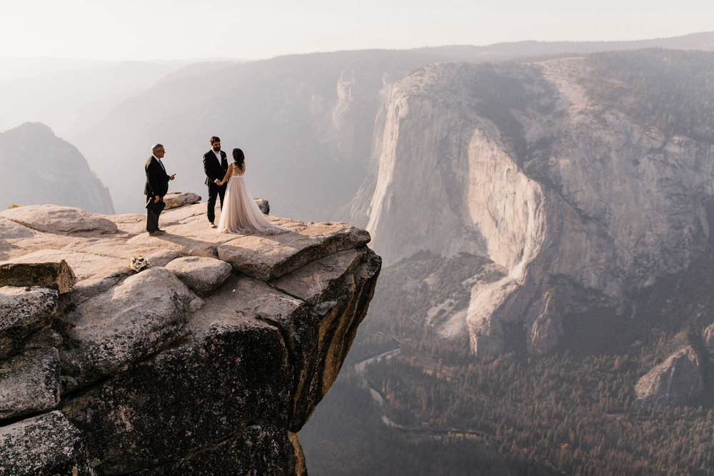 intimate elopement on the side of a cliff in yosemite national park | destination adventure wedding photographers | the hearnes adventure photography | www.thehearnes.com