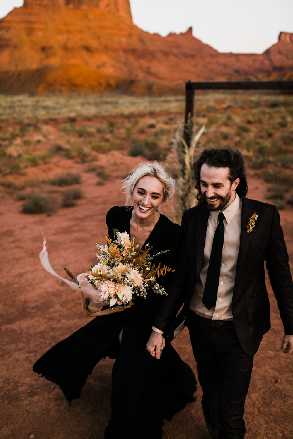 moab, utah elopement + black wedding dress | destination adventure wedding photographers | the hearnes adventure photography | www.thehearnes.com