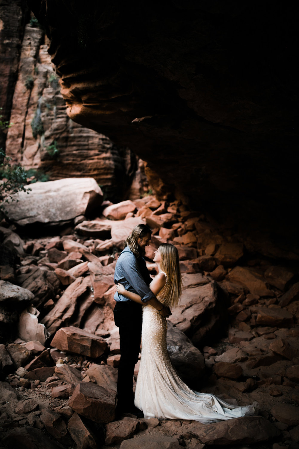 hike in elopement in zion national park | destination adventure wedding photographers | the hearnes adventure photography | www.thehearnes.com