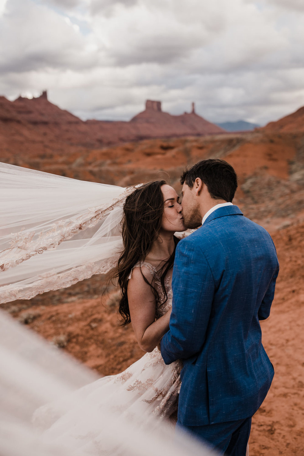 windy elopement in the moab, utah desert | destination adventure wedding photographers | the hearnes adventure photography | www.thehearnes.com
