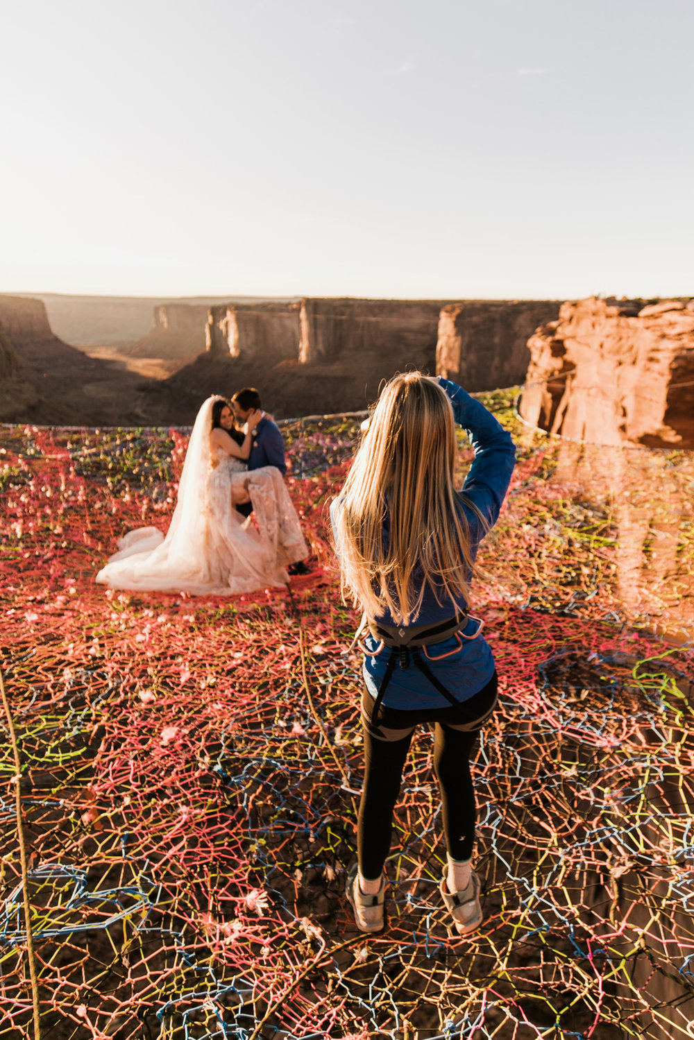 photographing a wedding on a spacenet in moab, utah | utah and california adventure elopement photographers | the hearnes adventure photography | www.thehearnes.com