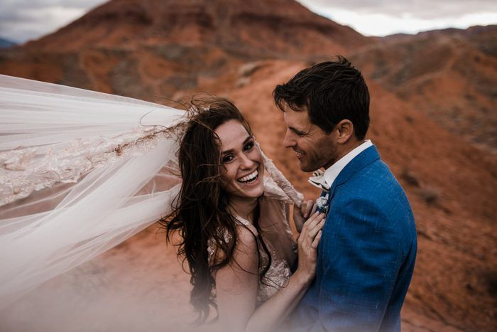 windy wedding day in the utah desert  | moab utah elopement photographers | the hearnes adventure photography | www.thehearnes.com