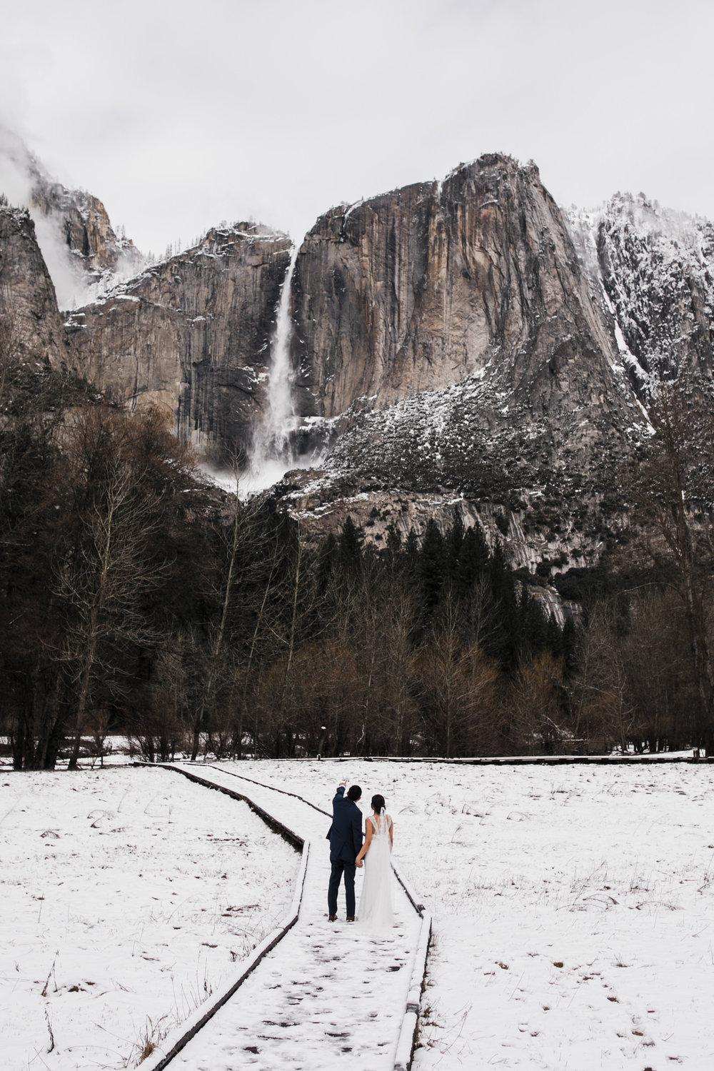 snowy waterfall elopement in yosemite
