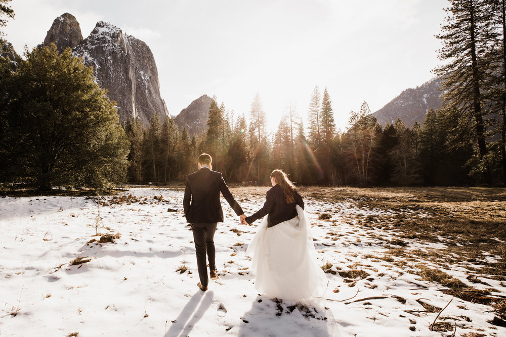 winter elopement first look in yosemite national park | The Hearnes Adventure Photography