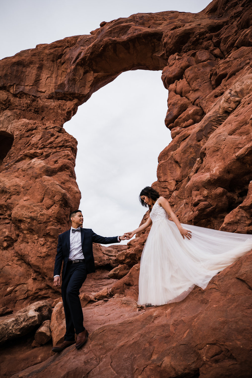 elopement first look in arches national park | desert elopement | moab wedding photographer | the hearnes adventure photography | www.thehearnes.com