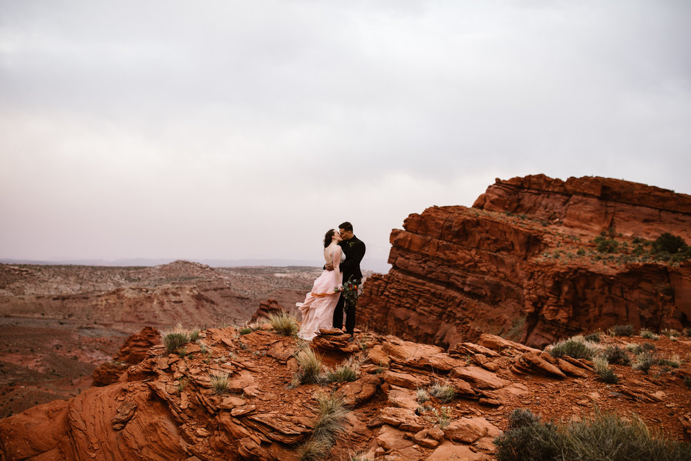 adventurous wedding in canyonlands national park | mesa arch elopement | moab adventure wedding photographer | custom pink wedding dress | www.thehearnes.com