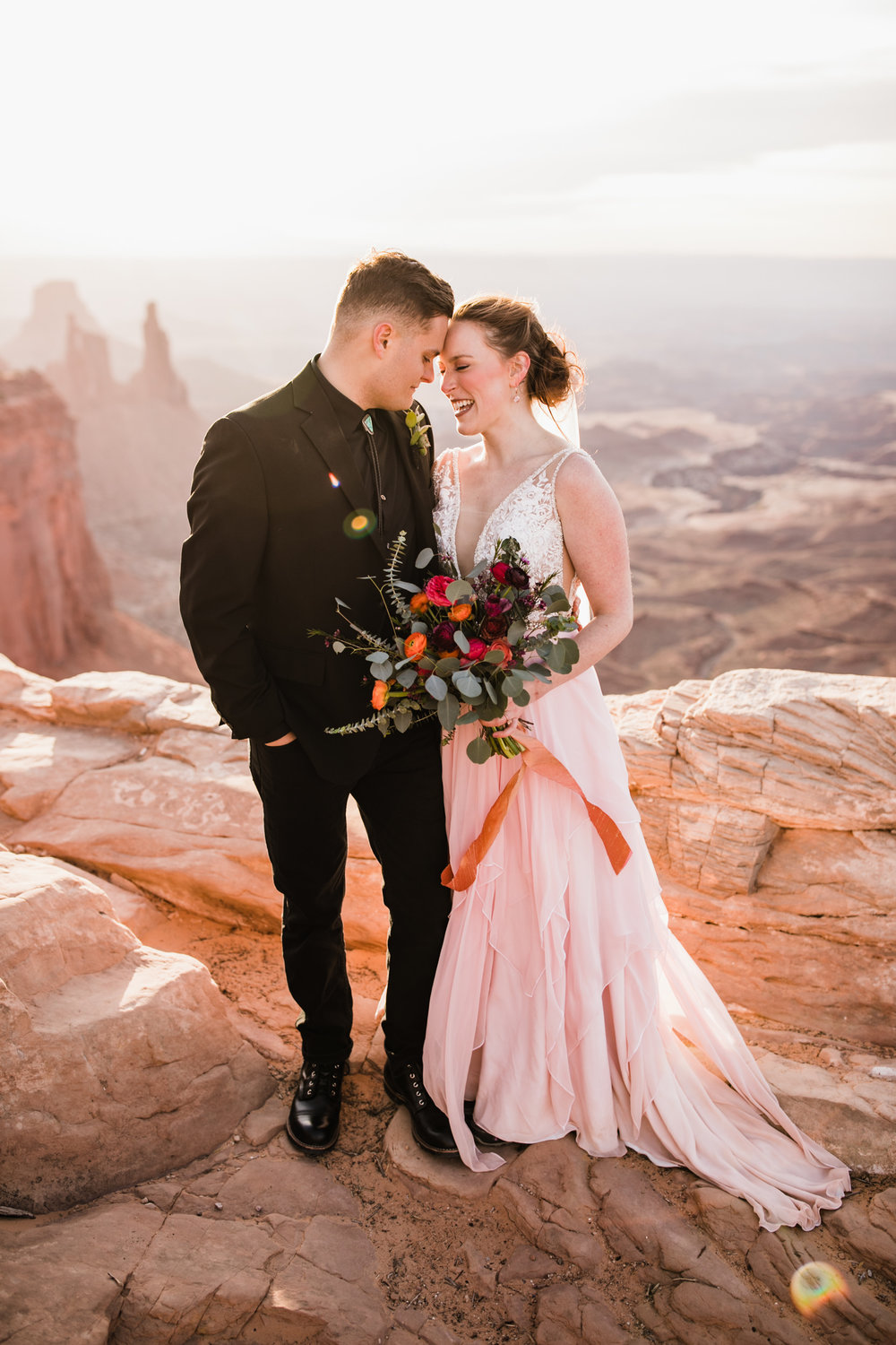 desert wedding in canyonlands national park | mesa arch elopement | moab utah wedding photographer | custom pink wedding dress | the hearnes adventure photography