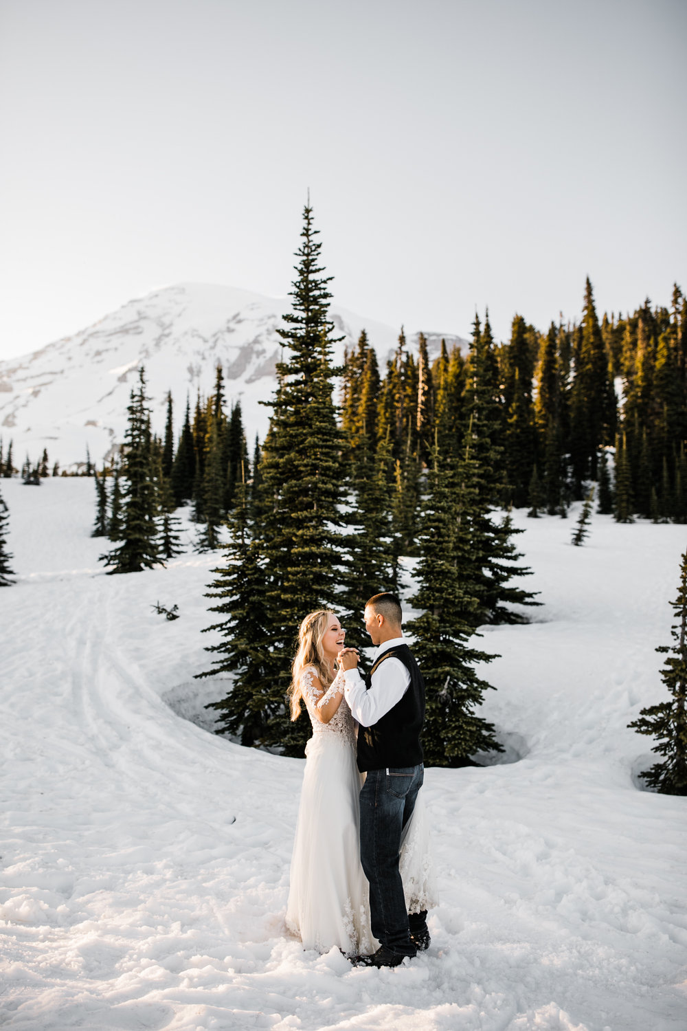 snowy wedding | long sleeve wedding dress | pendleton silver bark wedding blanket | wedding portraits in the snow in mount rainier | first dance in the mountains | national park elopement photographer