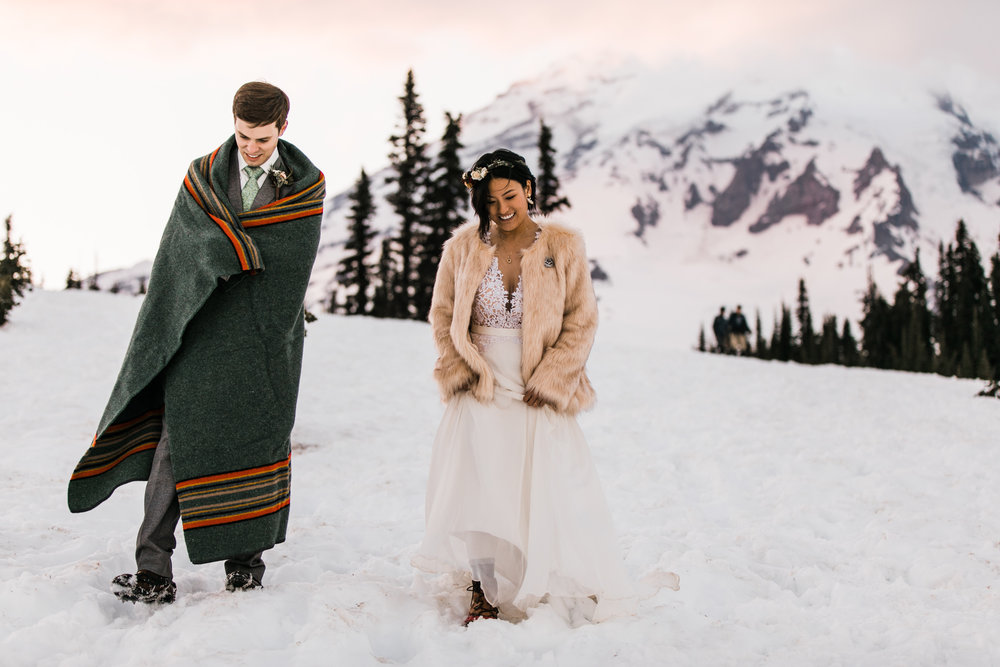 intimate wedding and reception in mount rainier national park | a frame cabin elopement first look | woodsy small reception in washington | snowy wedding portraits | elopement in the mountains