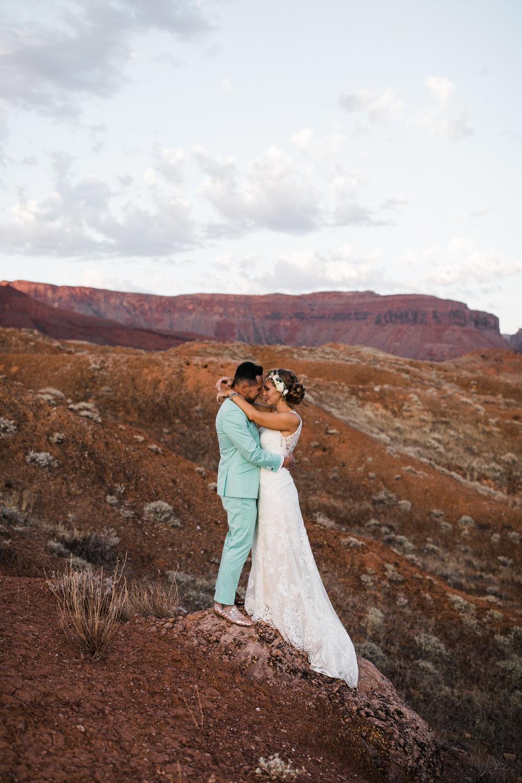 sunrise adventure wedding session |moab, utah elopement photographer | desert wedding inspiration | blue tux | mint colored suit | unique groom | the hearnes adventure photography