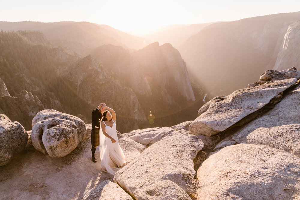 destination elopement in yosemite national park | ceremony + portraits at taft point | groom wearing a kilt + bride wearing boots | the hearnes elopement photography