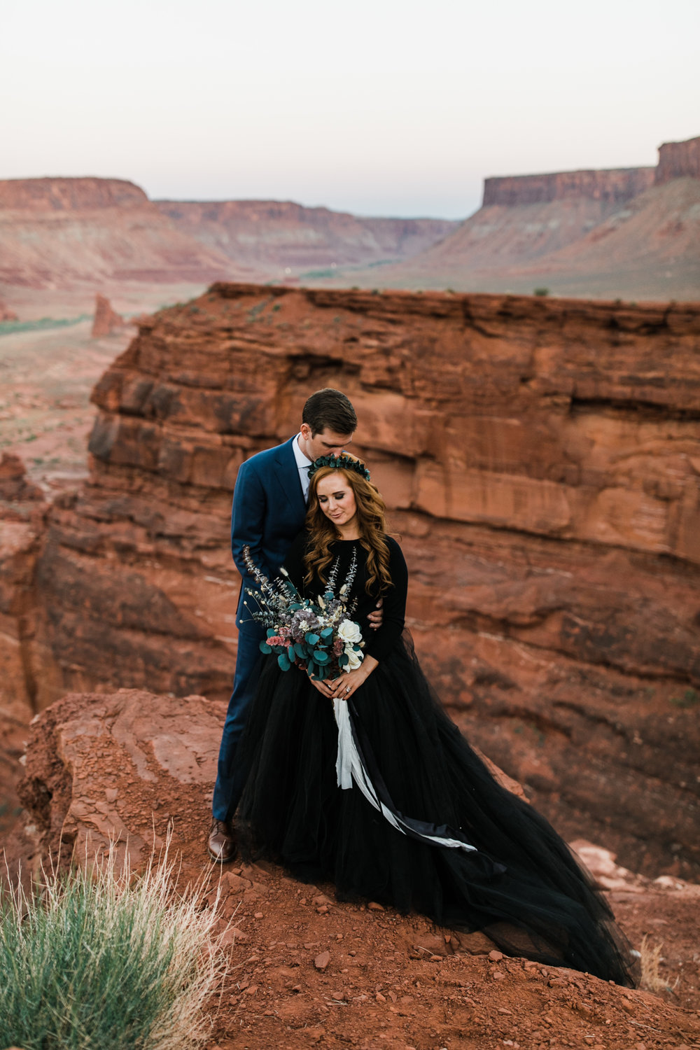 After wearing a white wedding dress for their sunrise first look in Canyonlands National Park, Rachelle changed into this gorgeous two-piece black wedding dress that was really a tulle skirt paired with a black sweater for a high-neck, long sleeve look.