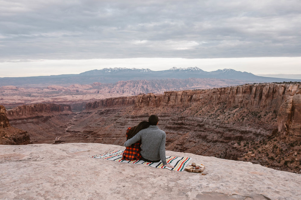 van life engagement photos | outdoor picnic in Moab, Utah | charcuterie and wine in the desert | the hearnes adventure photography