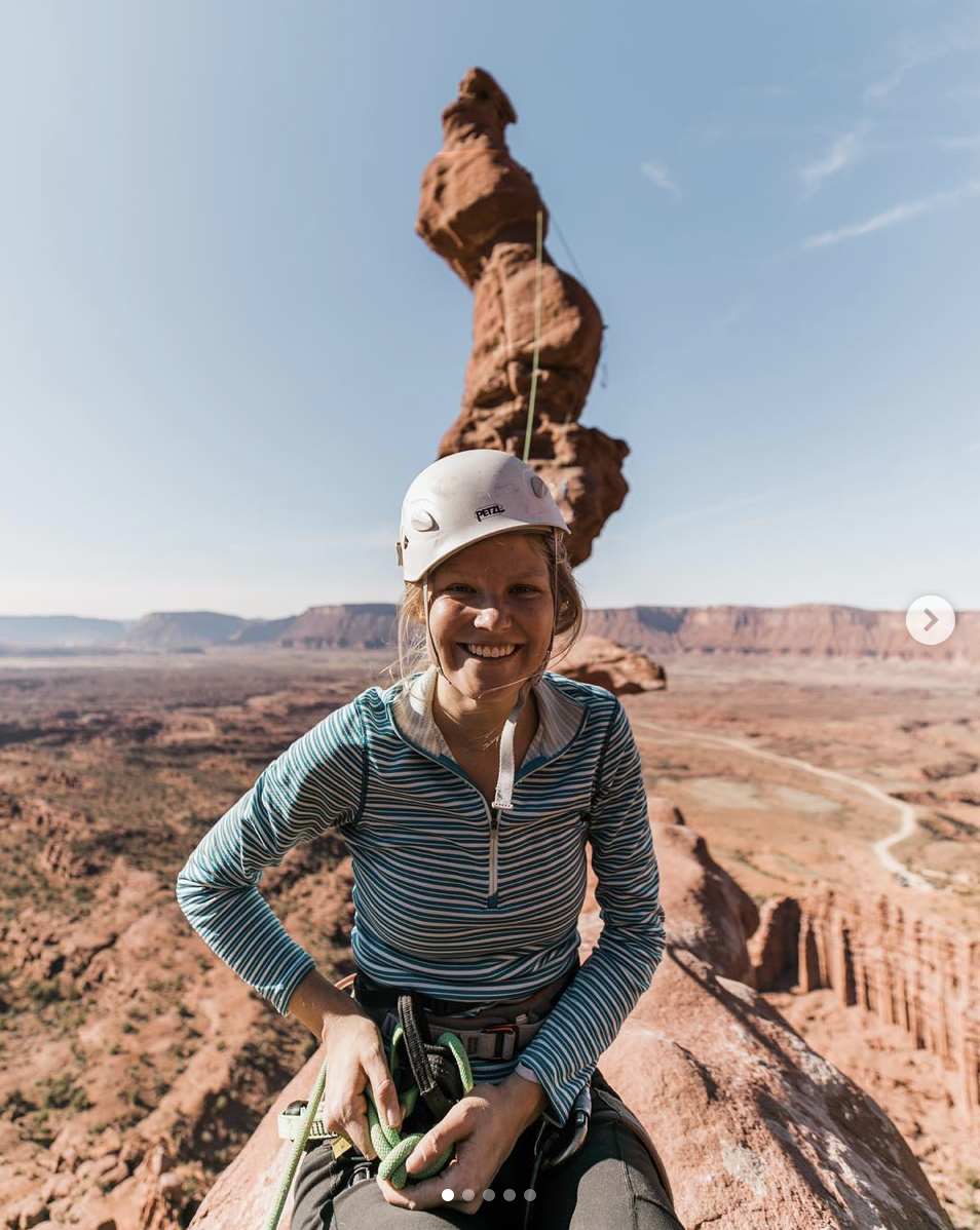 rock climbing girl in moab utah