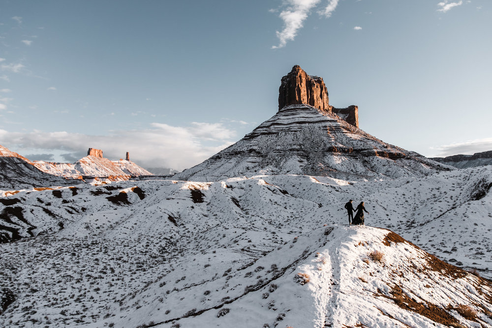 snowy engagement session in moab, utah