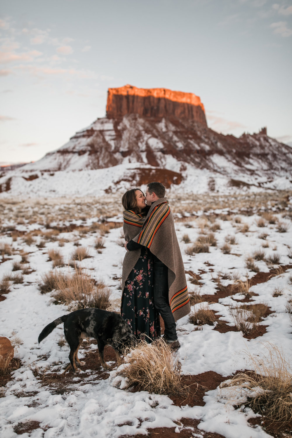 snowy engagement session in moab, utah with dogs