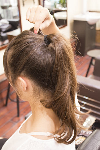 2. Using your fingertips, pinch hair to add shape.