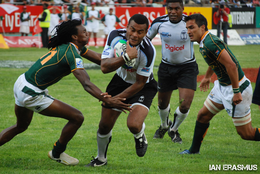 Danwel Demas and Neil Powell attempt to stop a Fijian plater - South Africa vs Fiji
