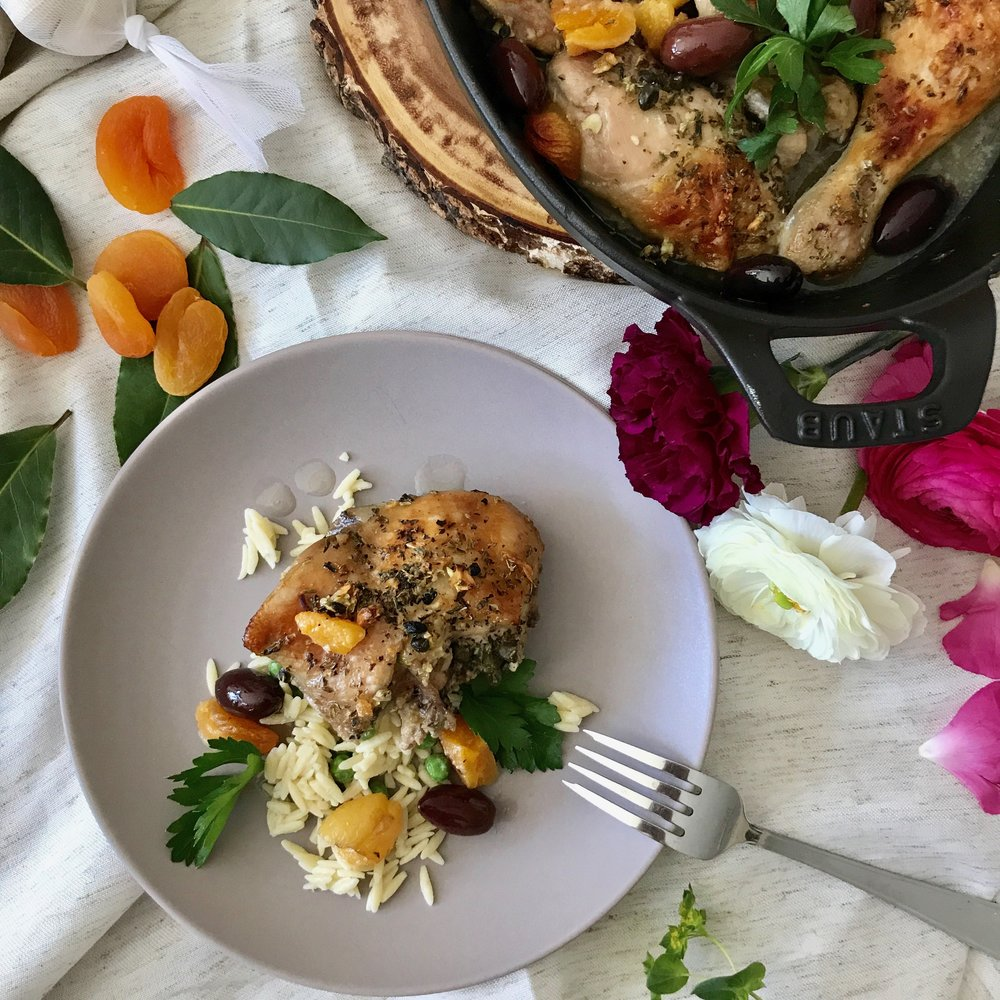 INGREDIENTS   1 3 to 4 lbs chicken, cut into 8 pieces ½ cup Kosterina Extra Virgin Olive Oil ½ cup sherry wine vinegar 1/3 cup capers, with 1/8 cup of juice 1 cup white wine 1/3 cup kalamata olives, pitted and halved 1 cup dried apricots 2 bay leaves 6 garlic cloves, peeled and minced 1 cup fresh oregano, chopped 1 teaspoon kosher salt 1 teaspoon freshly ground pepper ½ cup honey parsley, for garnish   1Place the chicken in a large bowl and pour olive oil, vinegar, capers/juice, wine, salt and pepper.  Mix to combine.  Place in the fridge, covered for at least an hour.  2Preheat the oven to 350 degrees 3Pour the contents of the bowl into a large baking dish.  4Arrange the olives, bay leaves, garlic cloves, oregano and apricots among the chicken pieces.  5Drizzle the honey over the chicken. 6Bake for 50 minutes to an hour, until juices run clear. 7Sprinkle with parsley and serve.