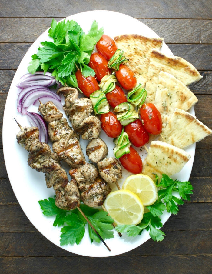 """INGREDIENTS (Serves 2 -4 ) 3 medium boneless and skinless chicken thighs or chicken breasts (about 1 lb.) ¼ cup Kosterina extra virgin olive oil 1-2 TBSP. fresh lemon juice 1 tsp. mustard 1 tsp. fine sea salt ½ tsp. freshly ground pepper 2 tsps. fresh thyme 1 tsp Greek dried oregano ½ tsp. paprika ½ tsp sumac toasted Greek pita wedges red onions, chopped fresh parsley, minced  INSTRUCTIONS 1. Dry the chicken well with paper towels. Trim it and cut it in pieces, about 1"""" to 1½"""". 2. Prepare the marinade: In a large bowl mix the Kosterina olive oil, the lemon juice, mustard and all the seasonings. 3. Place the chicken pieces into the marinade, cover and refrigerate for 4 hours. 4. Soak the bamboo sticks for 30 minutes into water. Thread four to five pieces of chicken to the skewers. 5. Grill the chicken, basting it once with any of the marinade that is left in the bowl. Do not overcook. 6. Transfer the kebabs to a platter, cover with a piece of foil and let it rest for 5 minutes. 7. Garnish the serving platter with the grilled Greek pita bread wedges, red onions, and fresh parsley.  NOTES: If using a charcoal grill, grill the chicken over direct, medium-high to high heat for 4-6 minutes per side. If using a gas grill, grill the chicken over direct heat for 4-6 minutes per side with a grill temperature (lid closed) about 400°F- 450°F. If you are grilling vegetable kebabs too, choose hearty vegetables that are good for grilling. Place the vegetables (or vegetable chunks) in a bowl and toss them with some Kosterina extra virgin olive oil, salt, freshly ground pepper and Greek oregano and then thread them through skewers. Depending on their size, the cooking time should be just about the same with the chicken kebabs. Grill until you see some nice grill marks, turning every three minutes or so and brushing them with the seasoned Kosterina olive oil."""