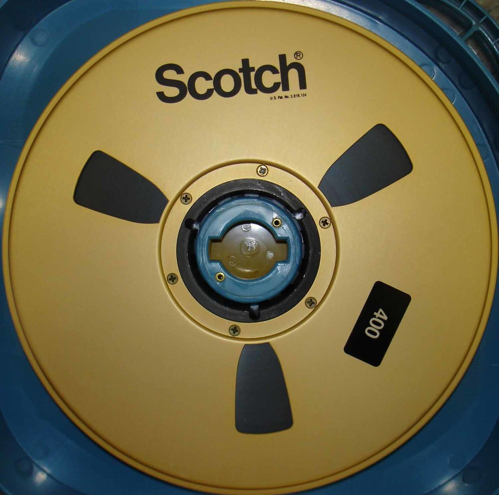 "A Reel of Scotch 3M 400 2"" Quad Videotape with the Foam Flange Inside of a Rigid Shipper."