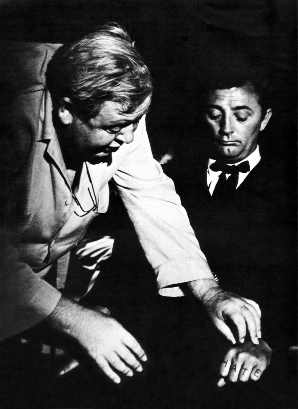 Charles Laughton-Annex   With Robert Mitchum (R) on the set of The Night of the Hunter,  Image Source