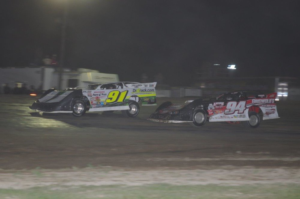 Chad Homan (No.91) and Bryce Davis (No.94) battle for a top-five position during Saturday's 65-lap Great Crate Race at Brighton Speedway. (Ken Kelly photo).