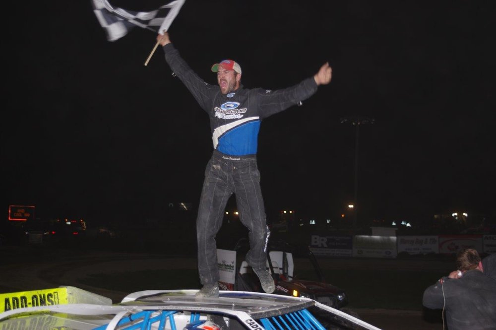 Charlie Sandercock celebrates his second straight Great Crate Race victory and a $6,000 payday at Brighton Speedway on Saturday night. (Ken Kelly photo).