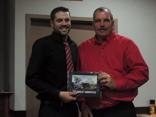 Charlie Sandercock (left) is presented with his championship plaque by series promoter Greg Belyea (right).