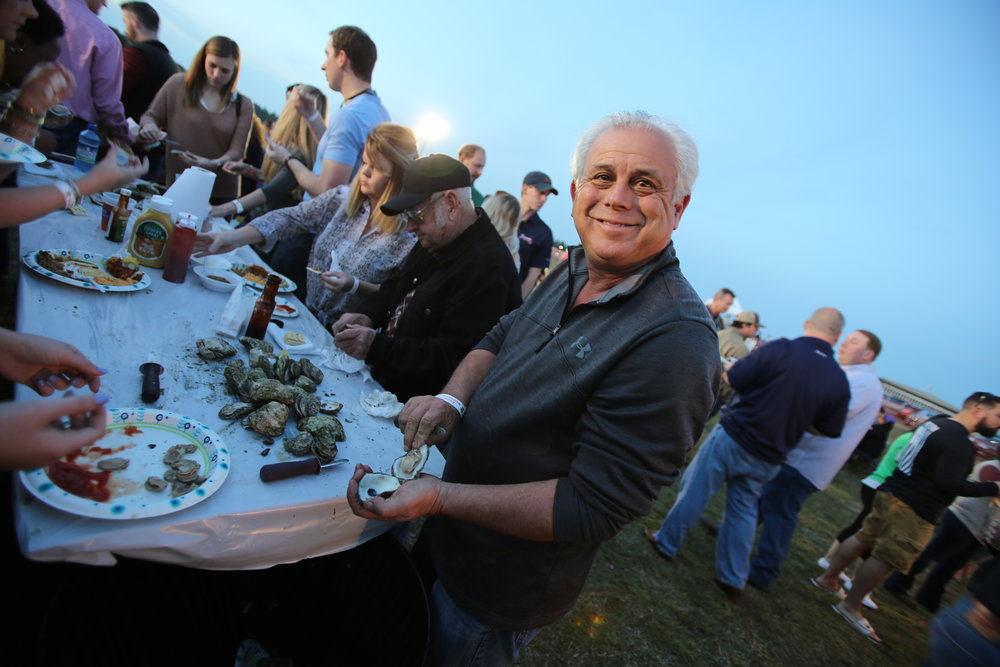 man smiling with oyster.JPG
