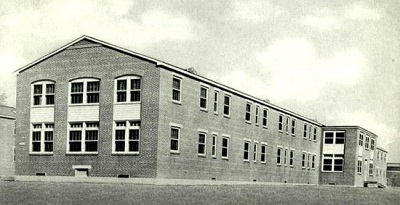 Partial view of one of the ward buildings of  Schick (91st) General Hospital , Clinton, Iowa. The Hospital was named after 1st Lt. William Rineheart Schick, MC, (1940-1941) and operated from 12 Feb 43 until 25 Feb 46.