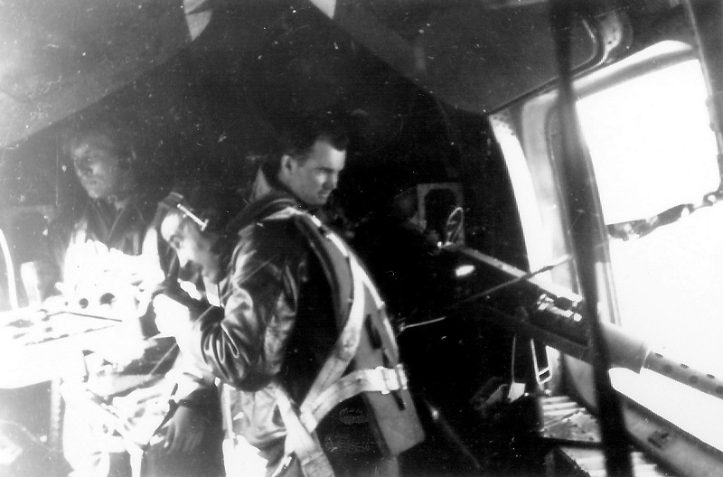 Waist gunner positions, showing closeness of the firing positions.  Persons unknown. Again, there is a third person present when normally there would be only two, again suggesting a training mission.