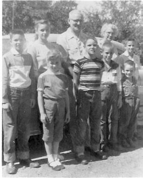 Harley and Floye Garrett with grandchildren, probably 1956, Des Moines, Iowa Front Row L-R: Barbara Ann Kunz, Dennis Garrett, Craig Garrett, Richard Kunz Back Row L-R: David and Judith Garrett, Harley and Floye Garrett, Kenneth Garrett
