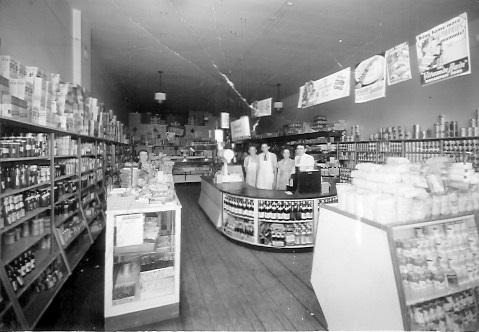 Easter's Store, Lorimor, Iowa, ca. 1941 Left to right: Hart Jones; Virgil Criss; Marian Garrett; Kenneth Garrett