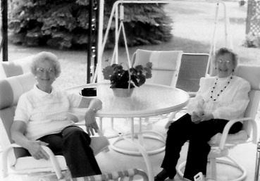 Mildred Kreie J anasak, left, and Marian Kreie Garrett Backyard patio, Mason City, Iowa, undated photo