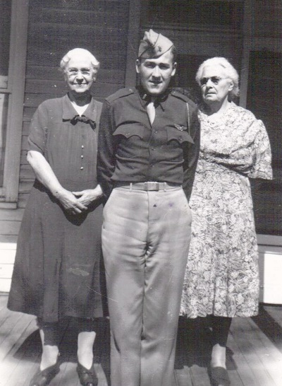 Lt. Maynard Jones posing with his grandmothers L-R: Eva Hyde Jones; Clementine DeMoss Shutts Probably summer/fall 1943, Location unknown