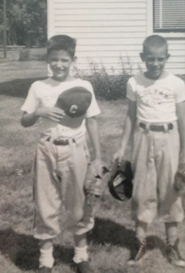 Jim Hamer, left, wearing a Sox Little League uniform. Craig Garrett, right, wearing a Cards Little League uniform by Jim's house. Notice my neat high-top shoes.