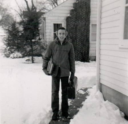 Classic picture of me with earmuffs, load of books in one arm and horn case in the other. Undated photo from next to house on South Locust.