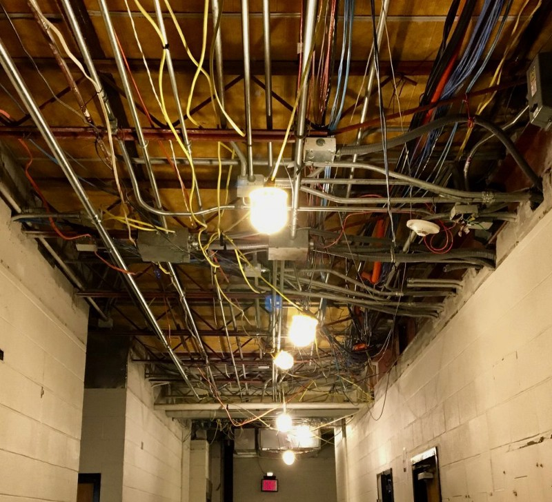 Exposed wiring as workers rebuild the original portion of the Adler Athletic Complex