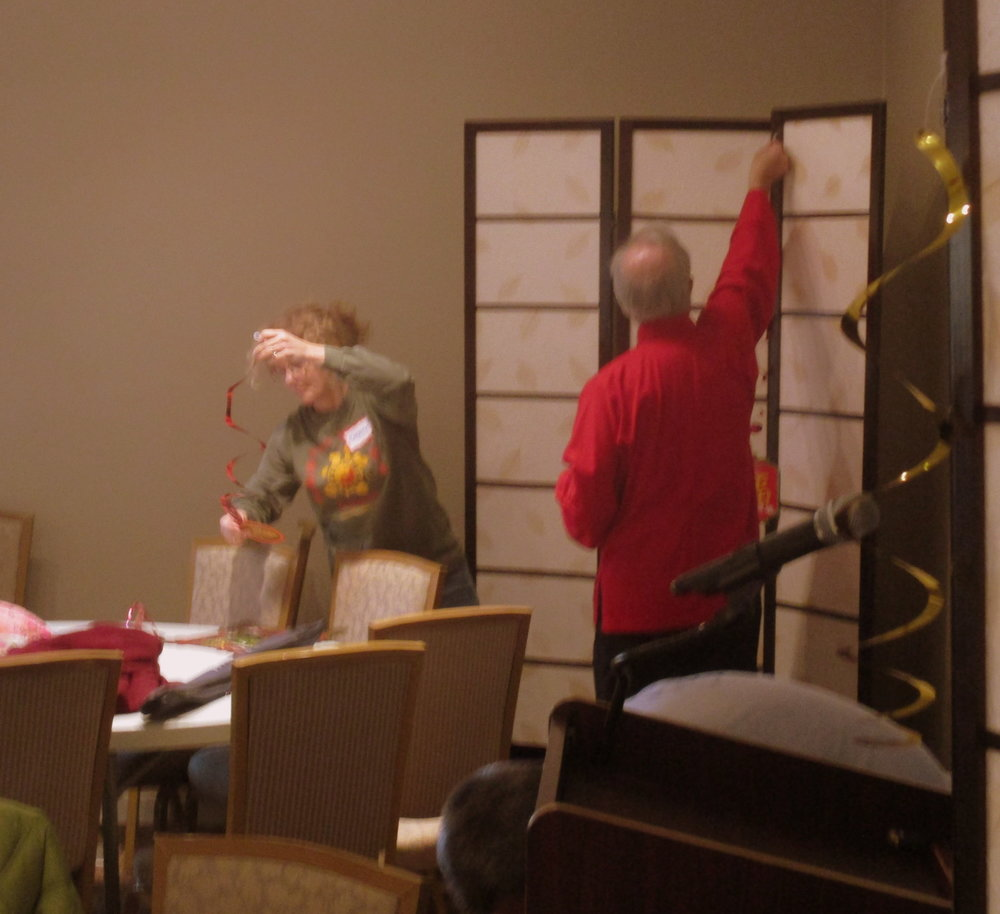 Helping Hands break down decorations