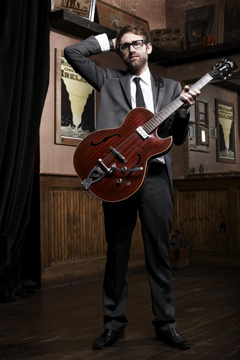 Jason Guitar Head Scratching.jpg