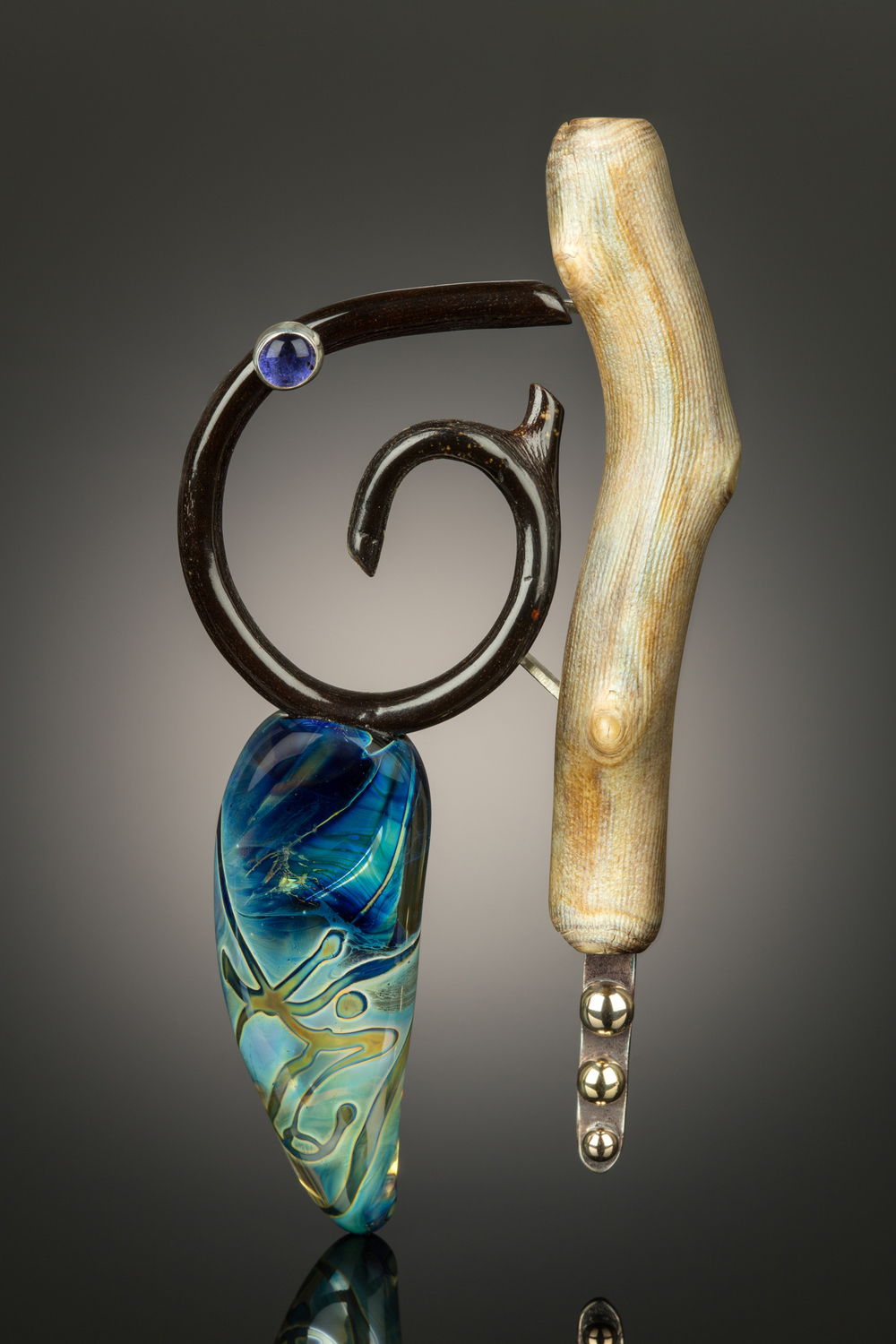 """Chaos"" brooch by Kristen Frantzen Orr and Gail Rappa was juried into the ""Hands of the Maker"" traveling exhibit by the International Society of Glass Beadmakers in 2015.  photo by David Orr."
