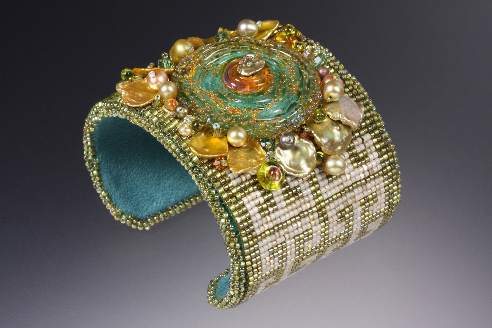 Maggie Roschyk combined her loomed beadwork with handmade glass discs made by Kristen Frantzen Orr.  photo by David  Orr